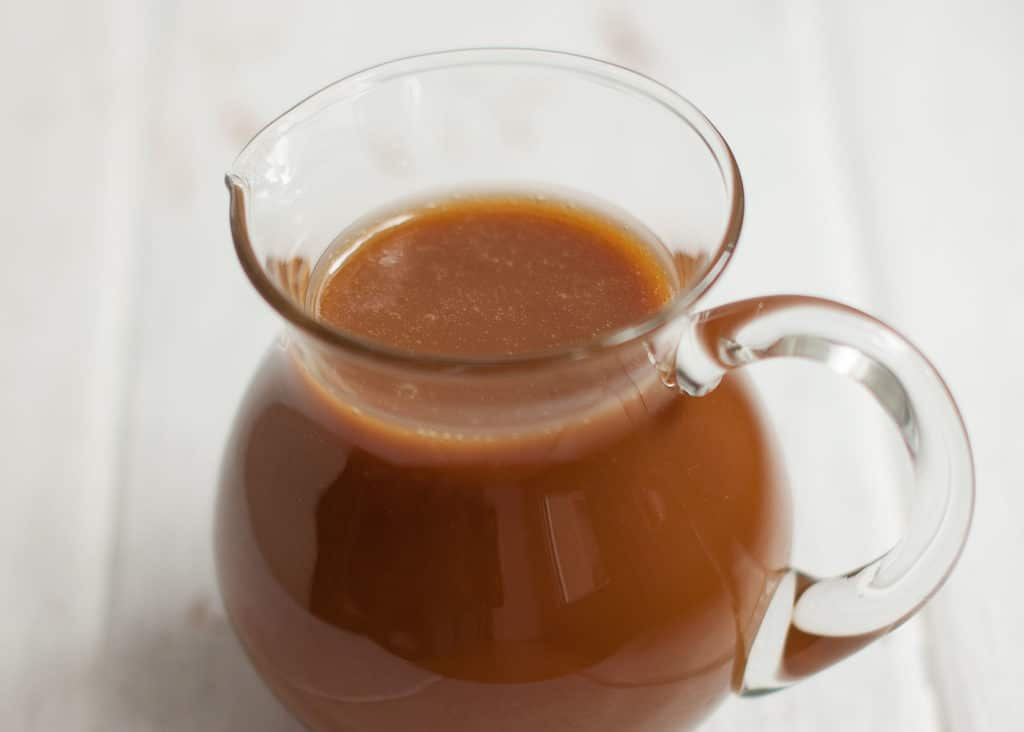 glass jug with toffee sauce