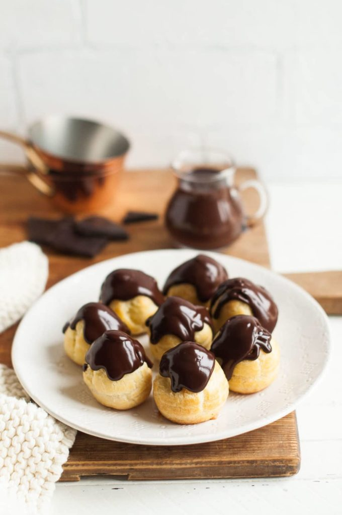 profiteroles filled with vanilla custard and drizzled with chocolate ganache