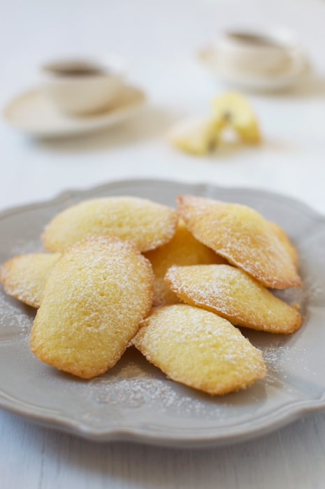 grey plate with stack of madeleines