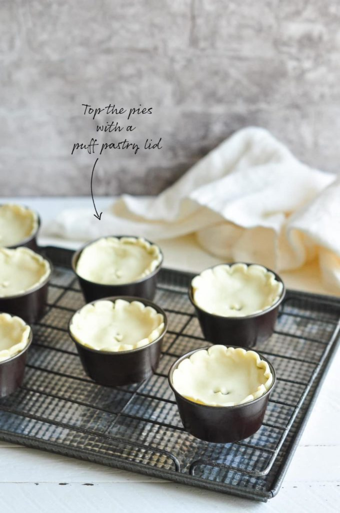 how to make meat pies, topping the pies with a puff pastry lid
