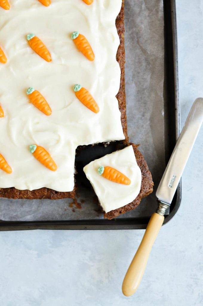slab of carrot cake with one slice cut out