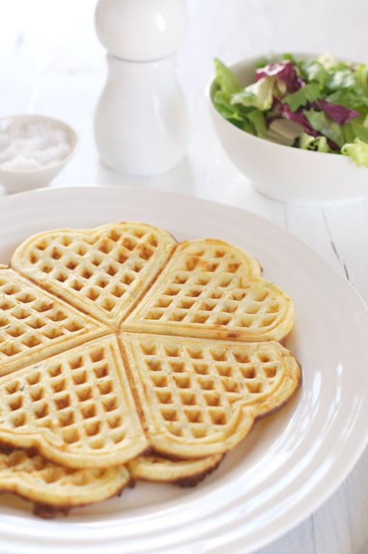savoury waffles on white plate with salad
