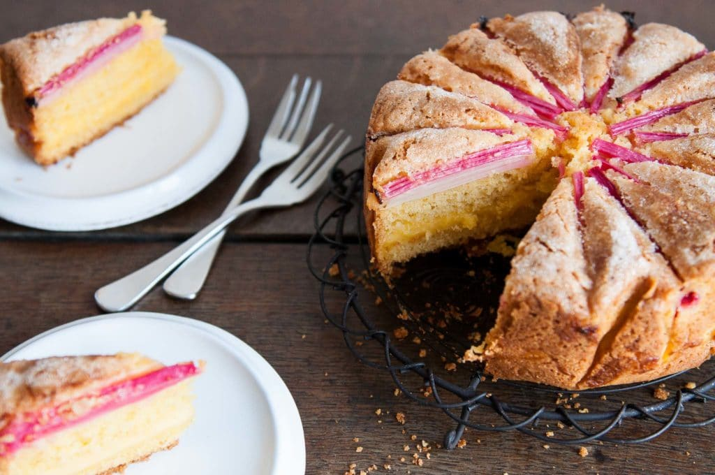 rhubarb custard tea cake sliced on wire rack with two forks