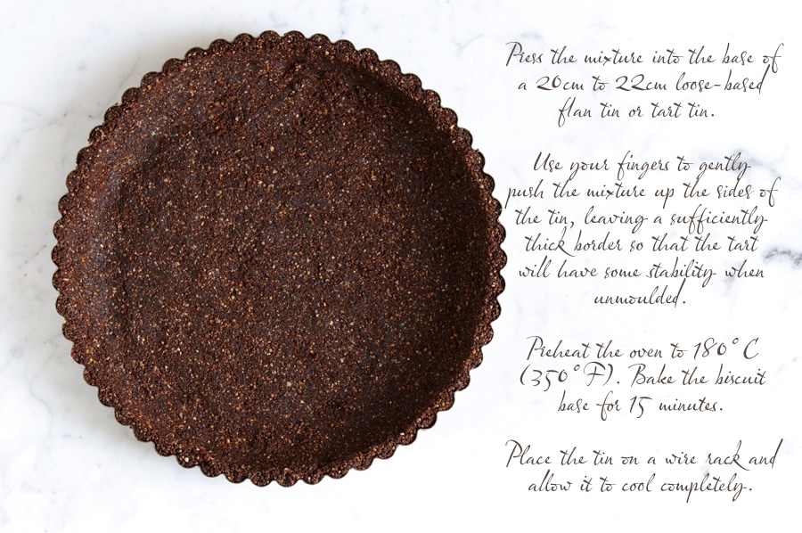 a tart tin filled with a biscuit base for a cheesecake