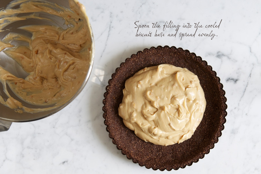 filling a tart tin with peanut butter cheesecake filling