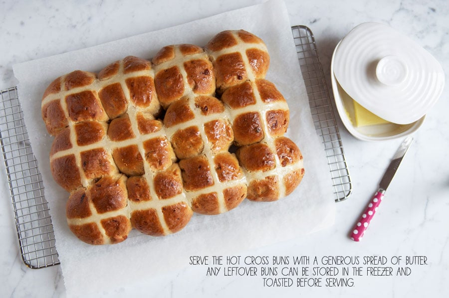 hot cross buns with glaze on wire rack
