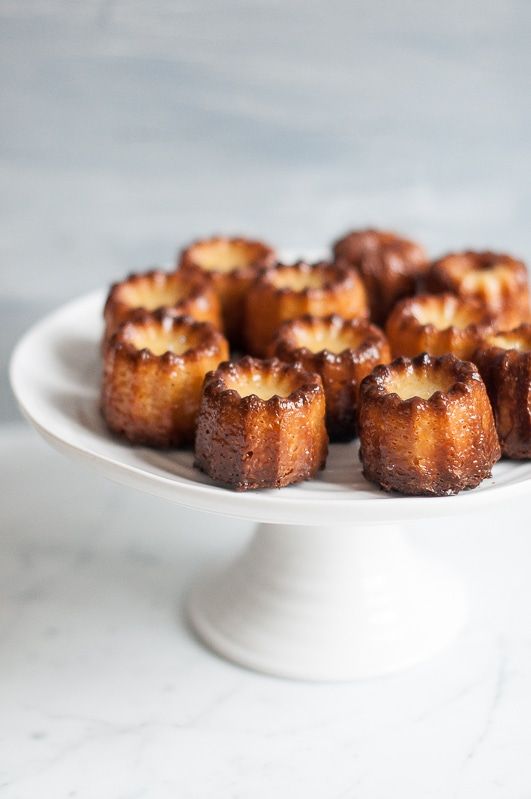 canneles on white cake stand