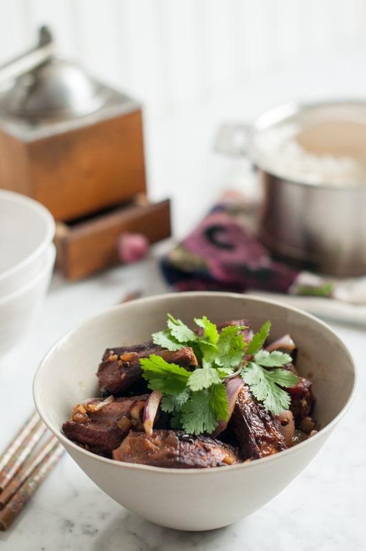 vietnamese pork ribs with saucepan of rice