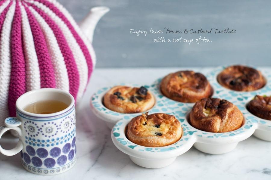 custard tarts with cup of tea