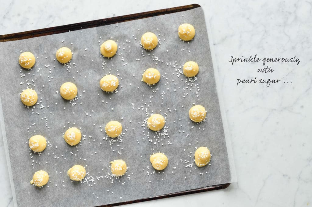 How to make chouquettes (french cream puffs). Sprinkle the dough with pearl sugar