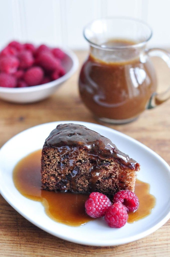 slice of sticky date cake or sticky date pudding drizzled with butterscotch sauce