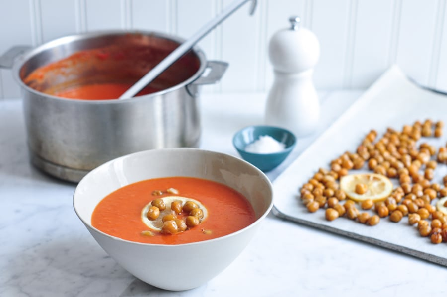 cream of tomato soup with crunchy lemon chickpeas in soup bowl