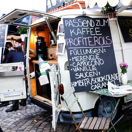 {My kind of food truck! Profiteroles with assorted fillings and sauces on offer.}
