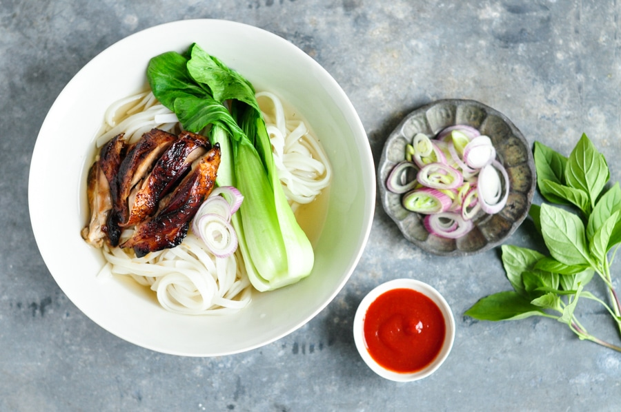 sticky chicken pho on grey table