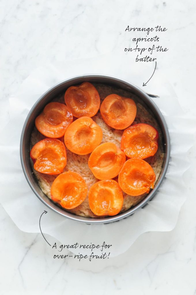 how to make apricot crumble cake, arrange the apricots on top of the batter