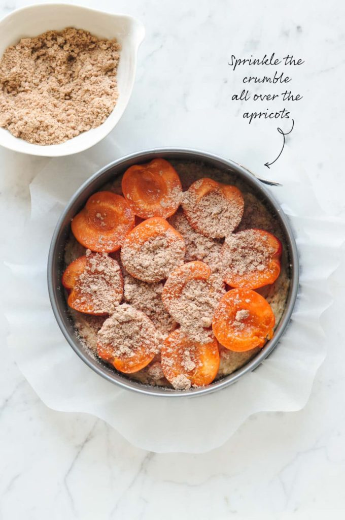 how to make apricot crumble cake, sprinkle the crumble over the apricots