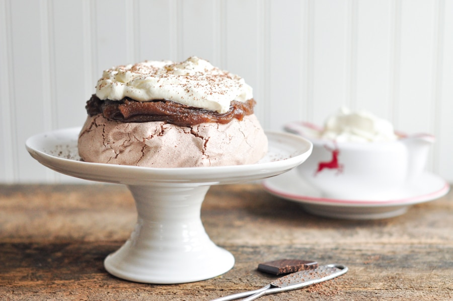 chocolate pavlova with chestnut purée on cake stand with jug of cream