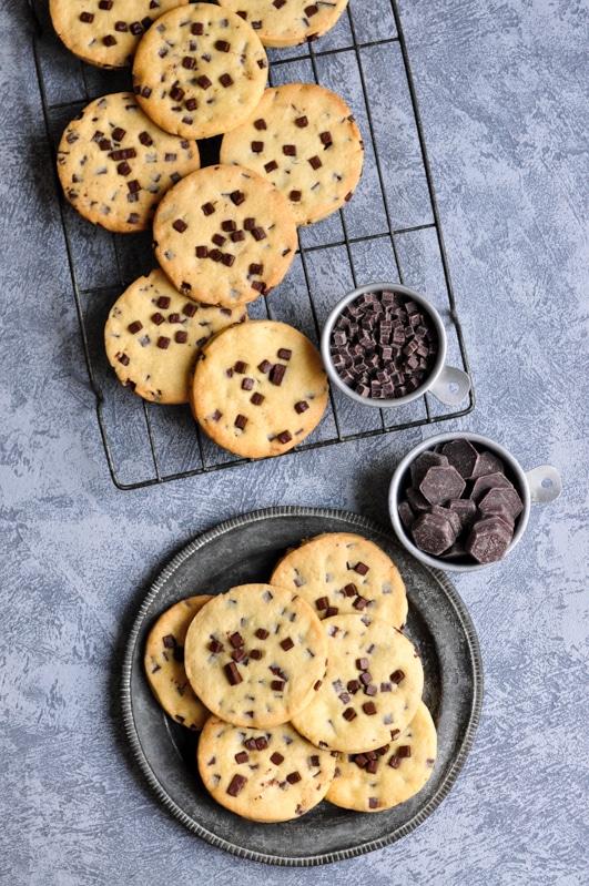 chocolate chip sable cookies on metal plate