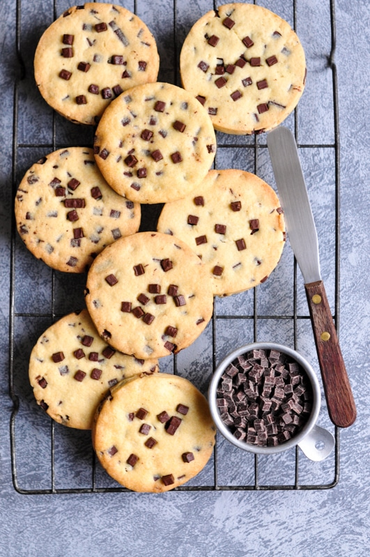 chocolate chip sable cookies on wire rack