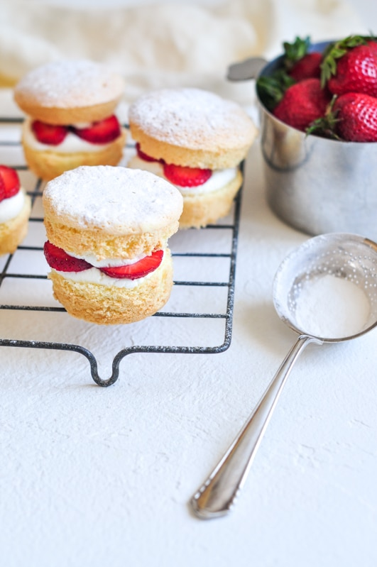 strawberry shortcake cakes with icing sugar duster