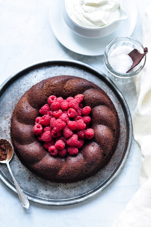 salted butter chocolate cake topped with raspberries