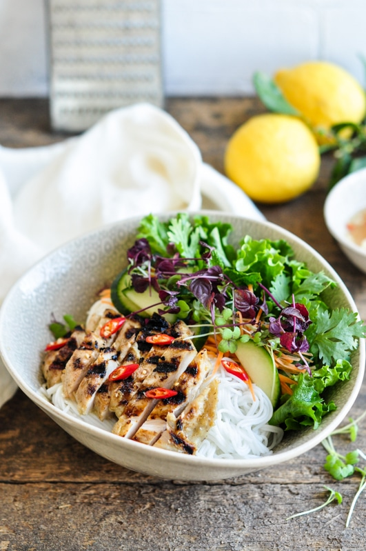 vietnamese lemongrass chicken noodle bowl with lemons
