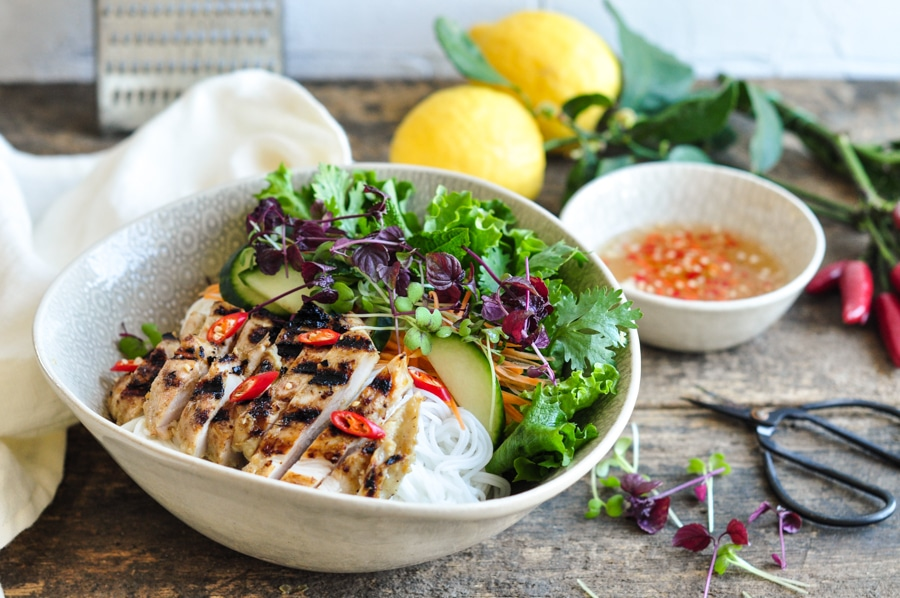 vietnamese lemongrass chicken noodle bowl with herbs