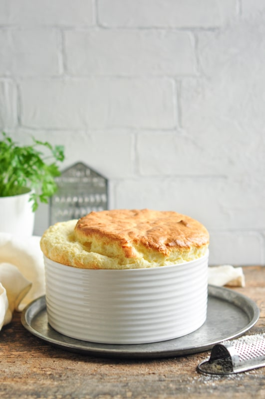 large cheese souffle with vintage grater