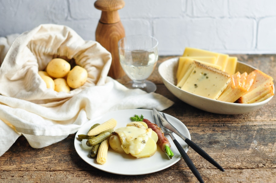 melted raclette cheese with potatoes