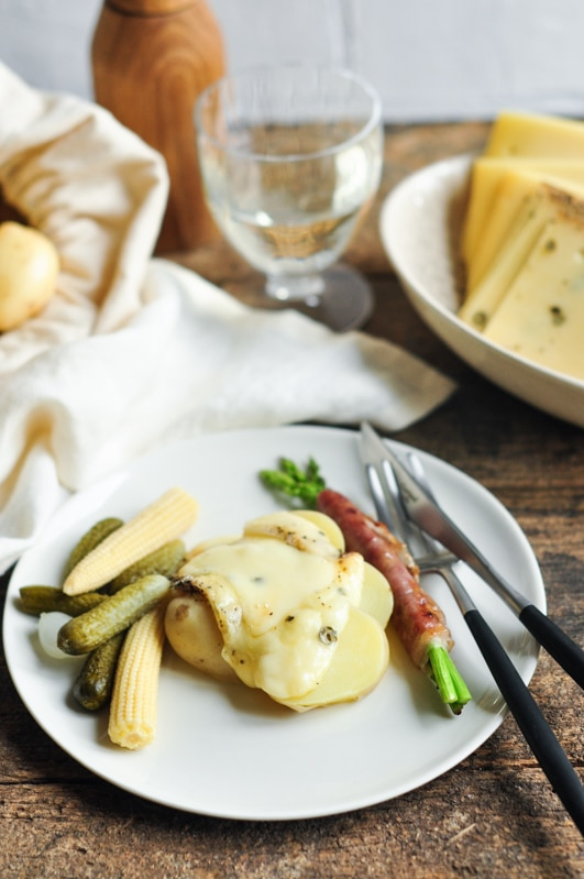 melted raclette cheese on potatoes