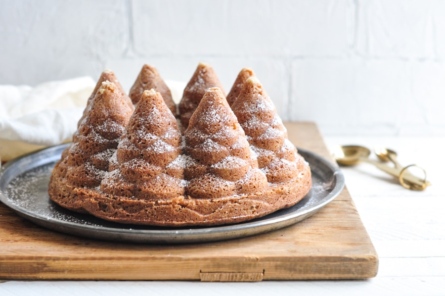 gingerbread christmas tree bundt cake with gold measuring spoons