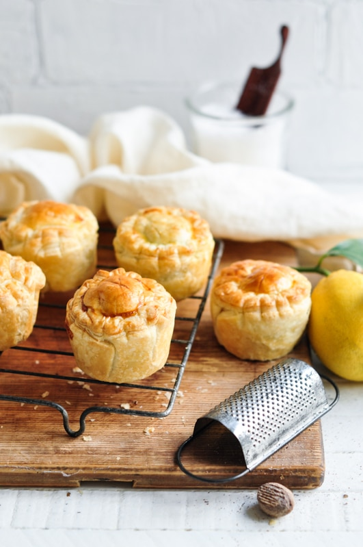 mini spinach and feta pies with nutmeg grater