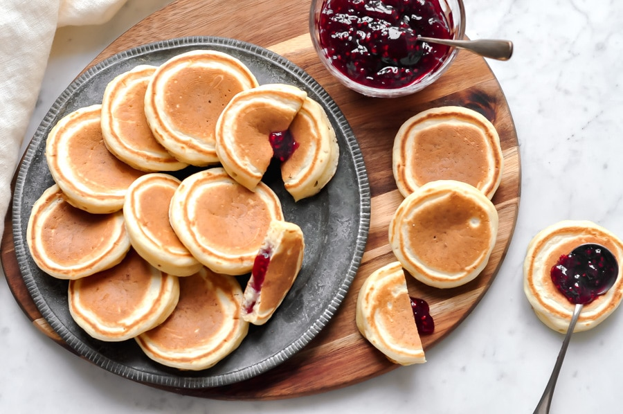 jam-filled pikelets cut on metal plate