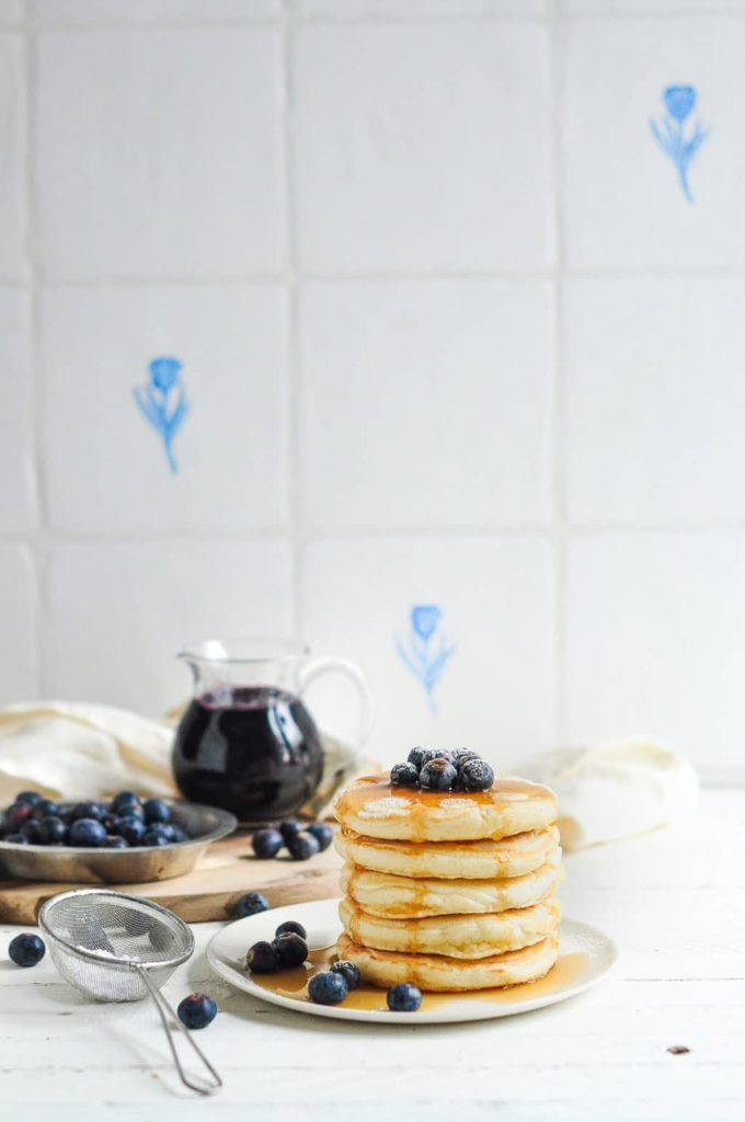 easy fluffy pancakes with blueberry sauce in jug