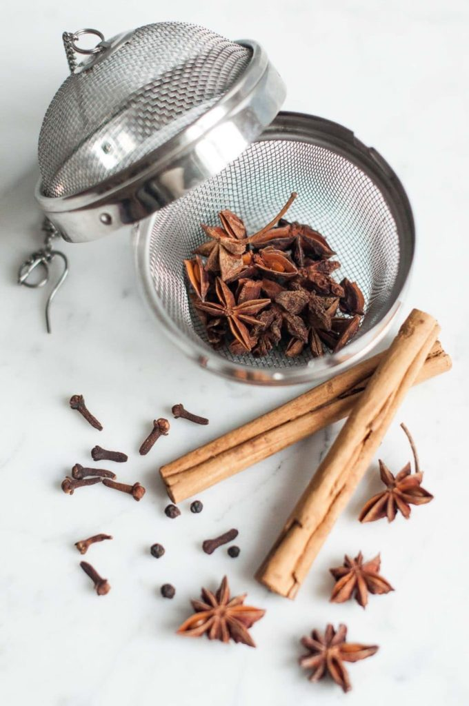 spice mesh strainer with star anise, cloves and cinnamon