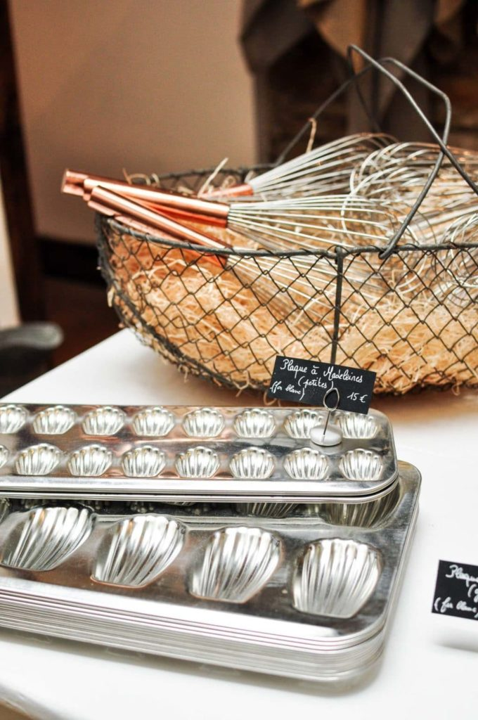 madeleine pans and copper whisks at the cook's atelier in beaune france