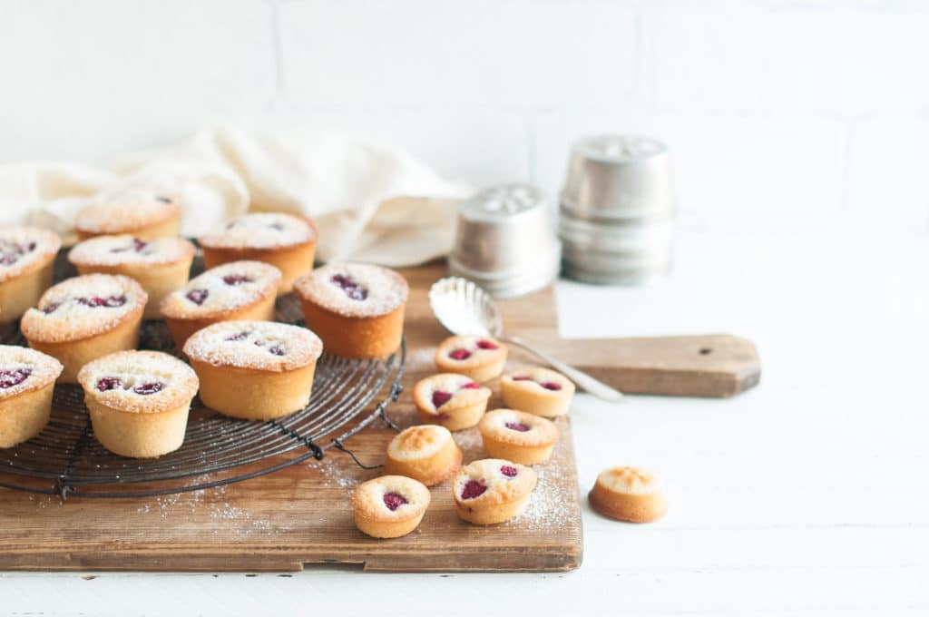 raspberry friands on wooden board