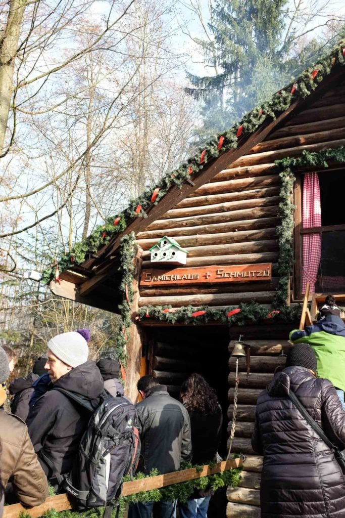 people lining up outside samichlaus' hut
