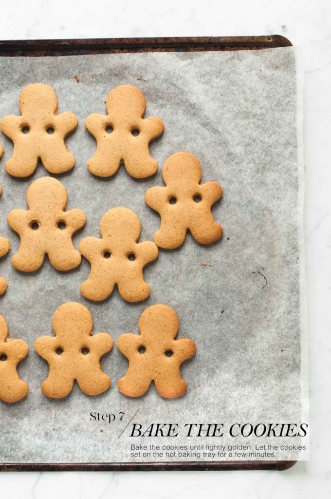 how to make gingerbread man cookies | baked gingerbread man cookies on cookie sheet