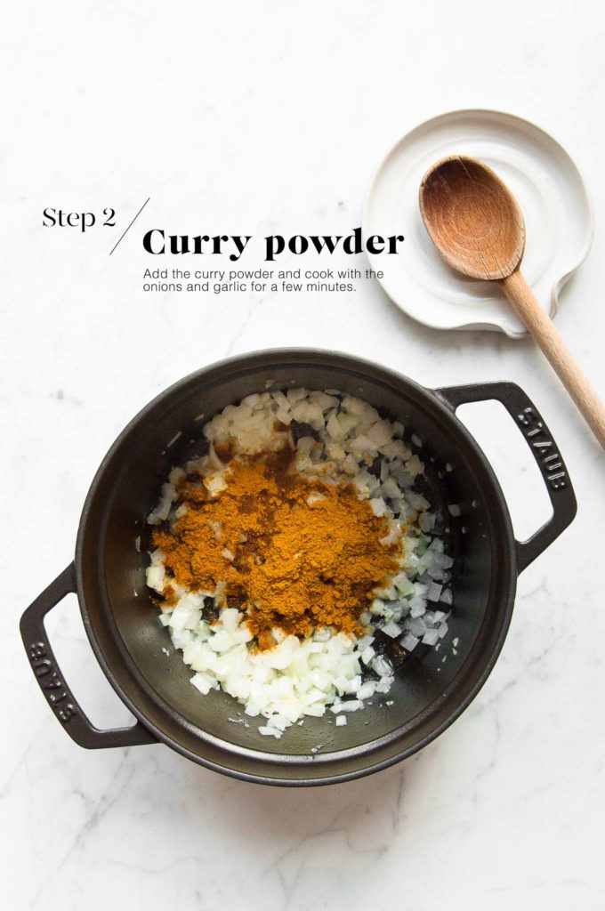 onions and garlic with japanese curry powder in cast iron pot