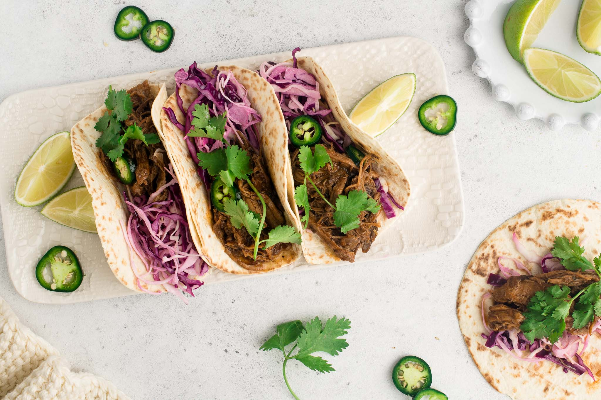 pulled pork tacos on white plate